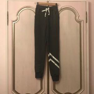 Grey sweatpants with diagonal stripes
